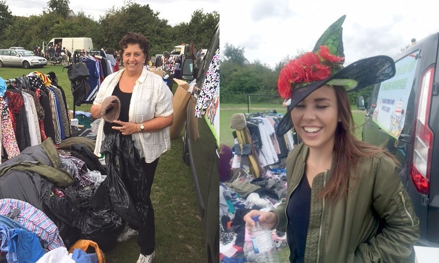 Helen happily loads her clothes rails while a smiling Amber models a 'Wicked' hat