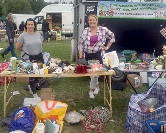 Jodi and Mandy proudly display their wares